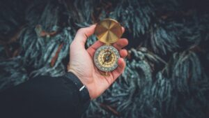 A compass showing you why discovering your values is more important than making money